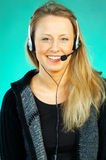 Woman with a Headset. Young pretty woman wearing a phone headset royalty free stock photography