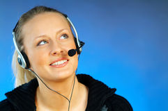 Woman with a Headset. Young pretty woman wearing a phone headset stock image