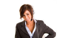 Woman with headset. Woman wearing a business suit and headset.  Isolated against a white background Royalty Free Stock Image