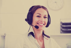Woman with headset in call center Royalty Free Stock Images