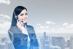 Woman with headset and a city Stock Image