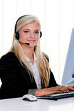 Woman with a headset and computer Hotline at Royalty Free Stock Image