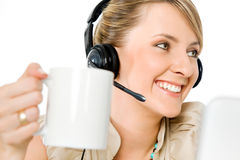Woman headset cup Royalty Free Stock Image