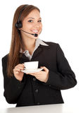 Woman in headset with cup Royalty Free Stock Images