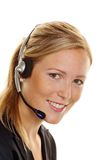 Woman with headset in customer service. Woman with telephone headset in customer service. Order acceptance and Hotline Stock Photos