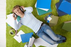 Woman with headset on floor Royalty Free Stock Photos