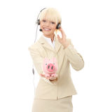 Woman with headset holding piggy bank Royalty Free Stock Photography