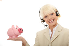Woman with headset holding piggy bank Stock Photography