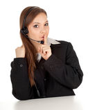 Woman in headset keeping silence Stock Photo