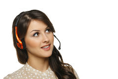 Woman in headset looking to side. Smiling cheerful support phone operator woman in headset looking to the side at blank copy space, isolated on white background Stock Photography