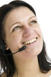 Woman with headset looking up Stock Image