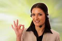 Woman with headset and microphone working in call center for hel Royalty Free Stock Image