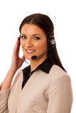 Woman with headset and microphone working in call center for hel Royalty Free Stock Images