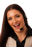 Woman with headset and microphone working in call center for hel Royalty Free Stock Photos