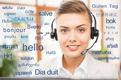 Woman in headset over words in foreign languages stock images