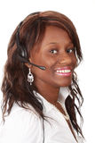 Woman with headset phone Stock Photography