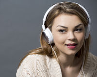 Woman and headset Royalty Free Stock Photography