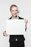 Woman with Headset and Sign Royalty Free Stock Photos