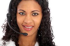 Woman with a headset smiling Royalty Free Stock Photos