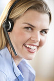Woman With Headset Smiling at Camera Royalty Free Stock Photography