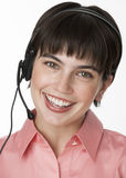 Woman With Headset Smiling at Camera Royalty Free Stock Photo