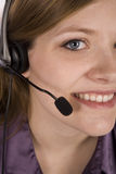 Woman with headset tight crop Stock Images