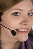 Woman with headset up  close Royalty Free Stock Photo