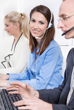 Woman with headset working in a call-center. Stock Image