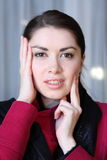Woman headshot dressed vinous coat Stock Photography