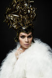 Woman in headwear and white fur coat Royalty Free Stock Images
