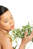 Woman with health skin and with olive tree Stock Image