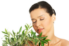 Woman with health skin and with olive tree Stock Photography