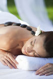 Woman At Health Spa Having Hot Stone Treatment royalty free stock photos