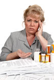 Woman with healthcare bills has headache Royalty Free Stock Images