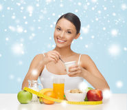 Woman with healthy breakfast and measuring tape Stock Photos