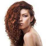 Woman with healthy brown curly hair Royalty Free Stock Image