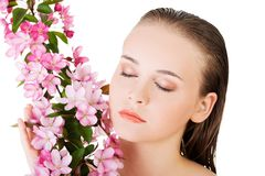 Woman with healthy clean skin and pink flowers Royalty Free Stock Photography
