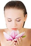Woman with healthy clean skin and pink flowers Stock Images