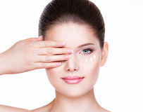 Woman with healthy face applying cosmetic cream. Royalty Free Stock Image