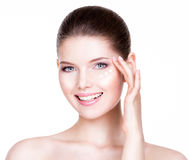 Woman with healthy face applying cosmetic cream. Royalty Free Stock Photo