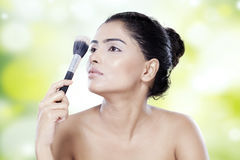 Woman with healthy face and makeup brush Royalty Free Stock Photo