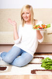 Woman and healthy food, Greek salad Royalty Free Stock Images