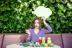 Woman with healthy food and thoughtful bubble stock image