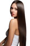 Woman with  healthy long hair. Beautiful girl with healthy long hair isolated on white Stock Image
