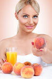 Woman with healthy peach juice Stock Images