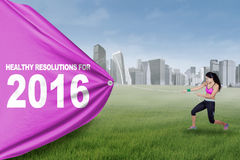 Woman with healthy resolution for 2016 Stock Image