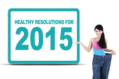 Woman with healthy resolutions for 2015 Stock Photo