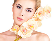 Woman with healthy skin and flowers close to face Stock Images