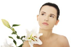 Woman with healthy skin and lily flower Stock Photo