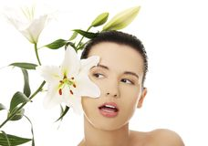 Woman with healthy skin and lily flower Royalty Free Stock Photo